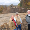 Rick Barbero/The Register-Herald<br /> Larry Mathis, Wyoming Commissioner, left, Richard Browning, executive director Coal field Expressway and Congressmen Nick Rahall,  look over the Coalfields Expressway construction site Thursday morning.