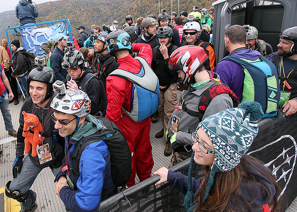 Brad Davis/The Register-Herald<br /> Base jumpers and andrenaline junkies from all over the world cram the waiting area atop the deck during the 35th Annual Bridge Day event Saturday afternoon at the New River Gorge Bridge.