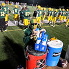 Brad Davis/The Register-Herald<br /> Decked out in Spartan colors, Greenbrier East equipment manager Zach Wright does the underrated yet critical job of keeping the team hydrated during their game against Parkersburg South Friday night in Fairlea.