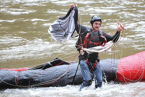 Rick Barbero/The Register-Herald<br /> Base jumpers lands in the river after leaping 800+ feet into the New River Gorge during the Bridge Day event Saturday morning in Fayetteville.
