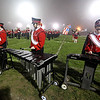 "Brad Davis/The Register-Herald<br /> Oak Hill marching band members (from left) Heather Martin, Meridian Fox and Emily McVicker tap out their notes on xylophones during halftime of the Red Devils' game against Point Pleasant Friday night. The three make up a critical subsection of the percussion group and call themselves ""The Pit."""