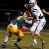 Brad Davis/The Register-Herald<br /> Parkersburg South quarterback Garrett Gilkeson tries to slip by Greenbrier East defensive back Ty Walker Friday night in Fairlea.