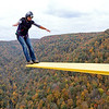 Brad Davis/The Register-Herald<br /> A fearless base jumper makes it look easy as she springs from the edge of a diving board extending from the deck during the 35th Annual Bridge Day Saturday morning at the New River Gorge Bridge.
