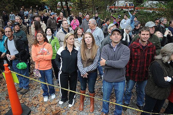 Rick Barbero/The Register-Herald<br /> Crowd watches base jumpers leaping 800+ feet into the New River Gorge during the Bridge Day event Saturday morning in Fayetteville.