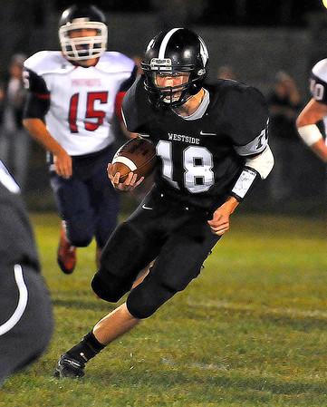 Brad Davis/The Register-Herald<br /> Westside running back A.J. Cook carries the ball against Independence September 26 in Clear Fork.