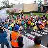 Brad Davis/The Register-Herald<br /> Competitors take off from the starting line along South Kanawha Boulevard as mayor Bill O'Brien, left, fires the starters gun during the opening moments of the Beckley Half Marathon Saturday morning.