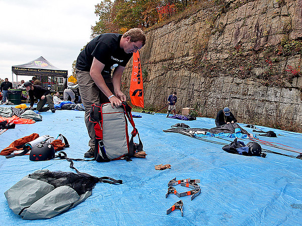 Brad Davis/The Register-Herald<br /> Base jumper and Shapleigh, Maine resident Mike King, left, packs his parachute and prepares his gear for another jump during the 35th Annual Bridge Day event Saturday afternoon at the New River Gorge Bridge.