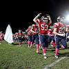 Brad Davis/The Register-Herald<br /> Independence players storm the field donning pink socks in honor of breast cancer awareness month as the Patriot cheerleaders sport all pink uniforms during their game against Liberty Friday night in Coal City.
