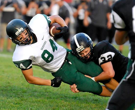 Brad Davis/The Register-Herald<br /> Wyoming East's Nik Walker is tackled by Westside's Trevor Anderson Friday night in Clear Fork.