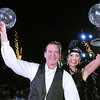 Rick Barbero/The Register-Herald<br /> Austin Caperton and Michelle Rotellini hold up the trophy after winning the judges and people choice award during the United Way of Southern West Virginia Dancing with the Stars event held at the Beckley-Raleigh County Convention Center.