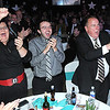 Rick Barbero/The Register-Herald<br /> Crowd react to the dance by Rocco Massey and Dr. Ayne Amjad friday night during the United Way of Southern West Virginia Dancing with the Stars event held at the Beckley-Raleigh County Convention Center.