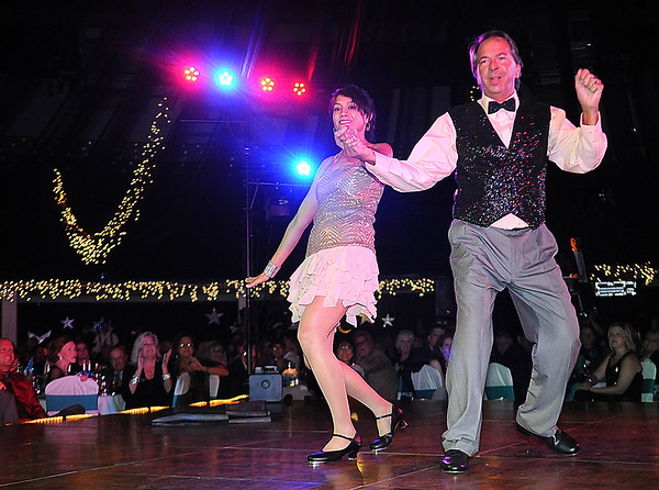 Rick Barbero/The Register-Herald<br /> Rocco Massey and Dr. Ayne Amjad dance friday night during the United Way of Southern West Virginia Dancing with the Stars event held at the Beckley-Raleigh County Convention Center.