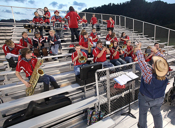 Brad Davis/The Register-Herald<br /> Band director Genia Sever, lower right, leads the Independence band as they keep the music flowing during the Patriots' road game at Westside Friday night in Clear Fork.