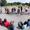 Brad Davis/The Register-Herald<br /> Mabscott Elementary students from the 3rd, 4th and 5th grades gather at the playground Friday afternoon to watch their teachers get doused with ice cold water as they answer Cranberry Elementary's nomination take part in the ALS Ice Bucket Challenge. From left is Mabscott teacher Emily Greene being doused by student Taejhonna Williams-Dancy, Adriana Boone being doused by student James O'Hara, Kellie Snuffer being doused by student Carlella Branch, Christy Delp being doused by student Amber Bowman and Crystal Lockhart being doused by students Kayla Bayne and Landon Davis.