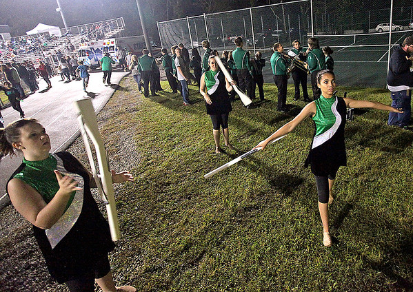 Brad Davis/The Register-Herald<br /> Members of Wyoming East's color guard warm up as the rest of the band prepares for their halftime show during the Warriors game against Summers County Friday night in New Richmond.