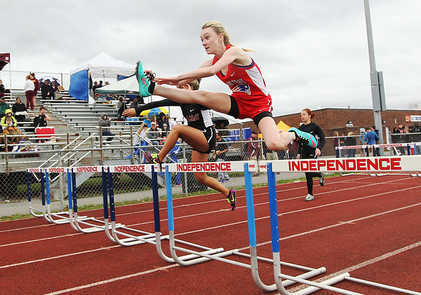 Chris Jackson/The Register-Herald<br /> Midland's Trail Stacy Ingram competes in a hurdle event during a track and field meet hosted at Independence High School in Coal City on Thursday. She won her event.