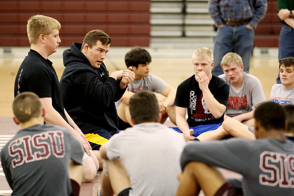 Chris Jackson/The Register-Herald<br /> West Virginia University head wrestling coach Sammie Henson conducts a wrestling clinic with former Independence and current WVU wrestler Chris Nelson at Woodrow Wilson in Beckley on Tuesday.