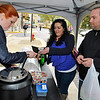 "Brad Davis/The Register-Herald<br /> Prosperity residents Tanairi Airey and her husband Kyle get themselves a second helping of Fa. So. Latte's ""Italian Wedding"" soup from co-owner Michele Davis, left, during Souper Saturday activities yesterday evening in downtown Beckley."
