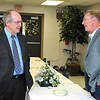 Brad Davis/The Register-Herald<br /> Marshall basketball coach and Mullens native Dan D'Antoni talks with Wyoming County Schools superintendent Frank Blackwell, left, Wednesday evening in Wyoming County.