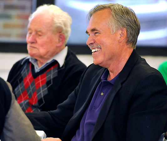Brad Davis/The Register-Herald<br /> Mullens native and former NBA head coach Mike D'Antoni (near) has a laugh as his father Lewis (background) looks on while brother Dan delivers his speech as the keynote speaker of the Mullens Area Chamber of Commerce Banquet Wednesday evening at Mullens Middle School.