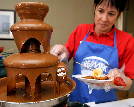 Brad Davis/The Register-Herald<br /> ReMax Vision Quest's Lori Taylor demonstrates the meaning of chocolate bliss Saturday afternoon in Lewisburg.