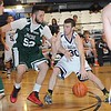 Rick Barbero/The Register-Herald<br /> Justin Noble, of Class AA, left, tries to steal the ball from, Derek Kirk, of A, during the Scott Brown Little General Classic all star game held at the Beckley-Raleigh County Convention Center.