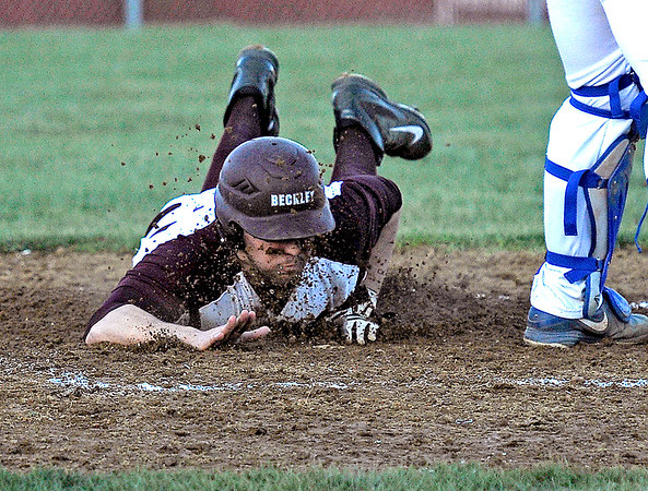 Brad Davis/The Register-Herald<br /> Woodrow Wilson's Brent Osborne gets a face full of dirt as dives in for a run during the Flying Eagles' rout of Capital Wednesday evening in Beckley.
