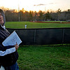 "Brad Davis/The Register-Herald<br /> Shady Spring baseball fan and parent Michael Schack takes in another game from the lofty view along the left field parking lot as the Tigers take on Woodrow Wilson behind him on a chilly but clear Wednesday evening. Schack hasn't missed a single home or away game this year as he watches his son, starting shortstop Brian Schack, during the games and maintains his own score book to keep track of how he's doing as the season progresses. ""It's how I know he's got a 14-game hitting streak going right now,"" Schack said of Brian's performance up to this point. Last year he had two sons to keep track of, as his older son Brendan played mostly at catcher last year before graduating and heading off to West Virginia Weslyan."