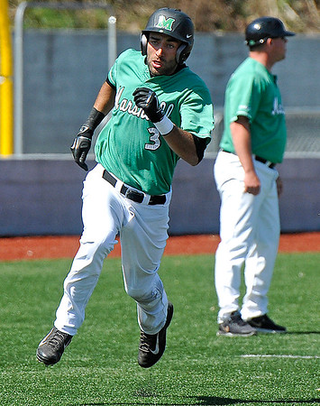 Brad Davis/The Register-Herald<br /> Marshall infielder D.J. Gee hustles around third to score off 1st baseman T.J. Diffenderfer's bases-loaded double in the bottom of the 7th that helped secure the Thundering Herd's 8-6 victory over Charlotte Sunday afternoon at Linda K. Epling Stadium.