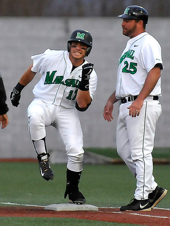 Brad Davis/The Register-Herald<br /> Marshall's Aaron Bossi strikes a quick celebratory pose for his teamates after his flare to right field scored the go-ahead run off Charlotte relief pitcher Brandon Vogler during the 6th inning of the Thundering Herd's win over the 49ers Friday night at Linda K. Epling Stadium.