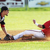 Chris Jackson/The Register-Herald<br /> Liberty's (3) makes the tag on Oak HIll's (7) during their baseball game in Oak Hill on Monday.