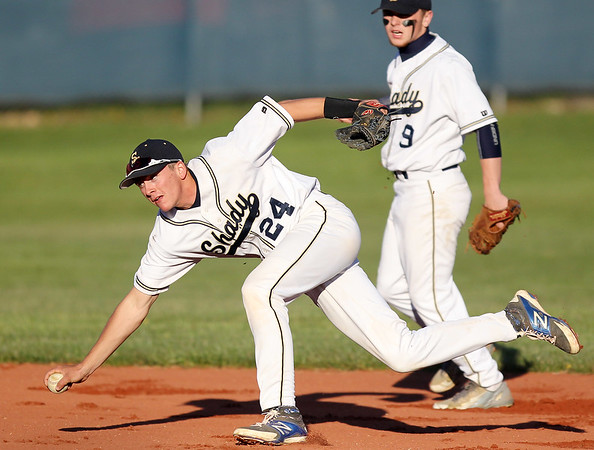 Chris Jackson/The Register-Herald<br /> Shady Spring's short stop (24) goes to dive on second base for an out during the second inning of their baseball game against Greenbrier East in Shady Spring on Tuesday.