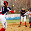Chris Jackson/The Register-Herald<br /> Independence shortstop Jessica Lilly (12) throws to Courtney Haga (1) as Summers County's Brittney Justice runs for third base during their softball game Monday in Coal City. Justice was safe on the play.