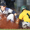 Chris Jackson/The Register-Herald<br /> Greenbrier East's Johnson (10) slides into Shady Spring's third baseman (10) during their baseball game Tuesday in Shady Spring. Johnson was safe on the play.