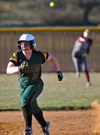 Brad Davis/The Register-Herald<br /> Greenbrier East's Lexi Tincher charges towards third base as the ball is thrown in from center field during a game at Woodrow Wilson April 1 in Beckley.