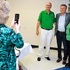Brad Davis/The Register-Herald<br /> Marshall basketball coach and Mullens native Dan D'Antoni poses for a quick photo with area residents and thundering herd fans Allen and Charlene Cook as Mullens Area Chamber of Commerce treasurer Terri Lusk fires away with a phone camera following the event Wednesday evening in Wyoming County.