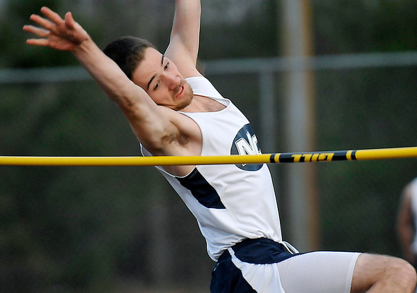 Brad Davis/The Register-Herald Nicholas County's Nich Girod clears five feet and four inches on a high jump attempt during Woodrow Wilson's track meet Thursday evening at Van Meter Stadium.