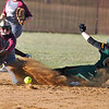 Brad Davis/The Register-Herald<br /> Greenbrier East's Cryslyn Dolan slides safely into second base as Woodrow Wilson shortstop Katie Bolen takes the throw on a short hop Wednesday evening at Woodrow WIlson High School.