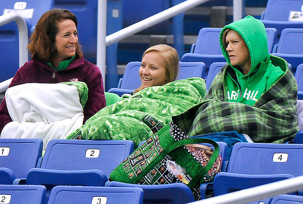 Brad Davis/The Register-Herald<br /> Marshall baseball fans and family members (from left) Monica Norman, Sydney Woody and Sandy Sago hunker down with several blankets as they take in the Thundering Herd's relocated game against Middle Tennessee State during a chilly and foggy Sunday afternoon at Linda K. Epling Stadium. Norman's son Austin is a Thundering Herd outfielder in the middle of his freshman year, so he doesn't get a whole lot of playing time, but his mother brought along Woody, his girlfirend, and Sago, his grandmother, along for the trip from their home town of Fairmont to support the team. The game was originally supposed to be in Charleston but was moved here due to weather.