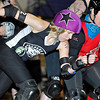 "Brad Davis/The Register-Herald<br /> Beckley Area Derby Dame Kati ""Phyliss Kill'er"" Grimmett, left, battles her way through traffic against the Eerie Roller Girls during a double header bout night at the Beckley-Raleigh County Convention Center April 18."