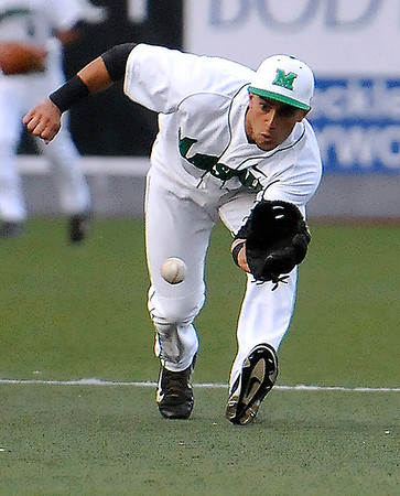 Brad Davis/The Register-Herald<br /> Marshall shortstop Sergio Leon keeps his eyes locked on the ball as he fields a grounder during the Thundering Herd's win over the 49ers Friday night at Linda K. Epling Stadium.