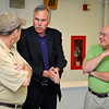 Brad Davis/The Register-Herald<br /> Mullens native and former NBA head coach Mike D'Antoni (middle) mingles with area residents Stuart King, left, and Dink Stump prior to the Mullens Area Chamber of Commerce Banquet Wednesday evening at Mullens Middle School.