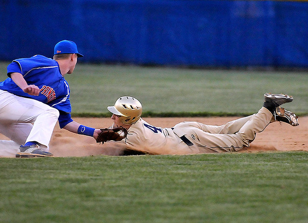 Brad Davis/The Register-Herald<br /> Greenbrier West's Dustin Yoakum steals second base during the Cavaliers' game against Princeton in the Jeff Treadway Memorial Wooden Bat Tournament April 24.
