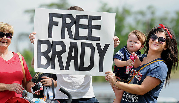 Rick Barbero/The Register-Herald<br /> Teresa Withrow, left, Jason Billings, Maverick Billing, 18 months, and Sarah Withrow, from Charleston, standing with a Free Brady sign during the New Orleans Saints and New England Patriots joint practice held at The Greenbrier Resort in White Sulphur Springs Wednesday morning.