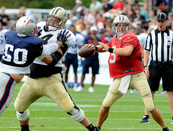 Rick Barbero/The Register-Herald<br /> Drew Bress, of New Orleans drops back for a pass duting the New Orleans Saints and New England Patriots joint practice held at The Greenbrier Resort in White Sulphur Springs Thursday morning.