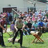 Rick Barbero/The Register-Herald<br /> Tyler Aldean, left, watches Rory Rosenberker throw an ax during the lumberjack show at the WV State Fair in Fairlea.
