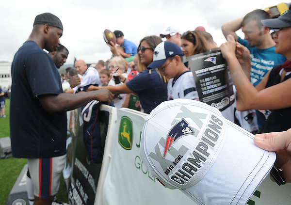 Rick Barbero/The Register-Herald<br /> Patriots players signing autographs after the New Orleans Saints and New England Patriots joint practice at The Greenbrier Resort in White Sulphur Springs Wednesday morning.