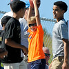 Brad Davis/The Register-Herald<br /> A lucky young fan celebrates after catching a ball during kicker's practice at New Orleans Saints practice Saturday morning in White Sulphur Springs.
