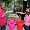 Brad Davis/The Register-Herald<br /> Greensburg, PA. sisters Madison Shirrell-Brown (left), 11, and Grace Morey, 8, learn how to make candles the old Appalachian way as they spend some time dipping wicks in hot wax then cooling them in water during a mountain crafts activity Saturday morning at the Beckley Youth Museum.