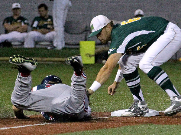 Brad Davis/The Register-Herald<br /> West Virginia third baseman Dan Ward tags out Chillicothe's Dylan Jones as he tries to get back to the bag after a strong relay from the outfield kept him from scoring during the Miners' 9-1 loss to the Paints Saturday night at Linda K. Epling Stadium.